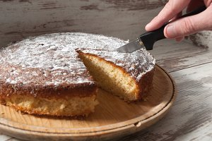 Cutting a piece of sponge cake