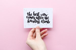 Girl's hand holding card with quote