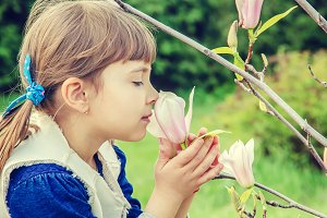 Blossoming magnolias and a child.