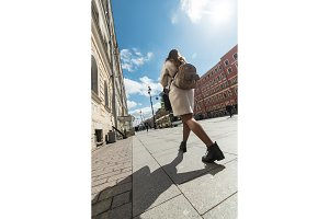 Young woman traveling backpacker outdoor in Saint-Petersburg street. Travel, hiking concept