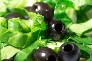 Vegetarian dish of olives, spinach