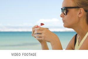 Woman eating ice-cream on the beach