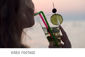 Woman drinking mojito with a straw