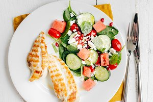 Grilled chicken with salad on plate