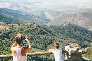 Woman takes picture at the mountain