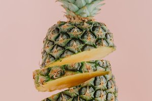 Colorful sliced pineapple on pink