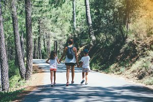Family walking at the forest