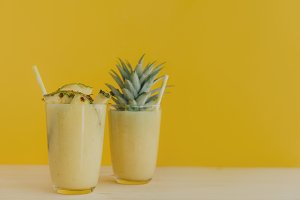 Smoothie with pineapple on yellow