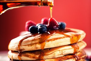 Pancakes with berries and maple syru