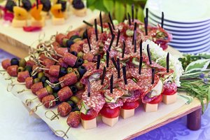 canap on skewers with salami and olives