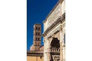 Arc de Titus and Basilica di Santa Francesca Romana in Rome, Ita