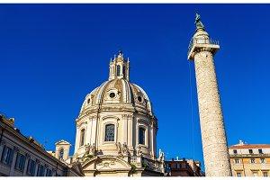 Trajan's Column and Santissimo Nome di Maria al Foro Traiano Church in Rome