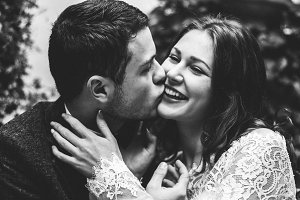 Beautiful wedding couple kisses