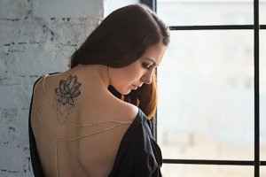 Girl with tattoo lotus