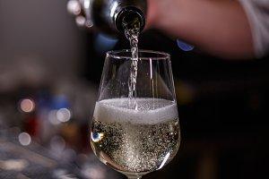 Barmann pours champagne