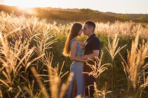 Attractive couple in field