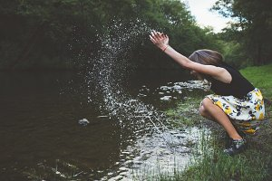 Happy teen girl in the river