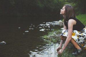 Happy teen girl in the river