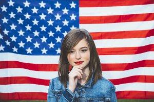 Happy teen girl with flag