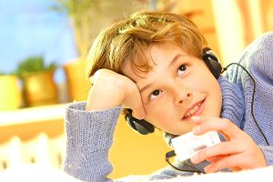 Boy listening the music in his room