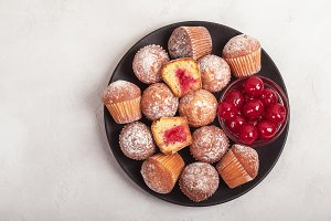Muffins with cherry jam.