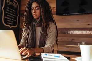 Freelancer woman working on laptop