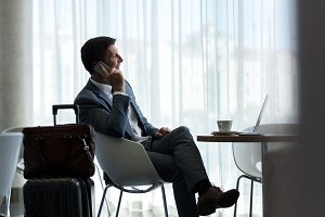 Businessman at airport lounge
