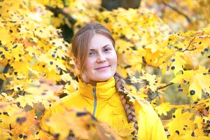Pretty young woman in leaves