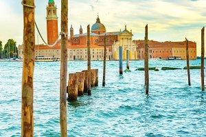 Gondolas with wooden poles in Venice