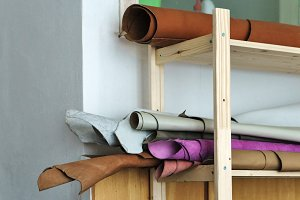 Segments of leather on rack