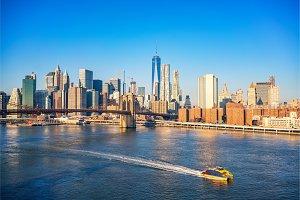 Brooklyn bridge and Manhattan at sunny day