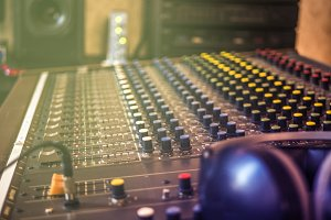 close up vintage sound recording console with headphones on top with headphones on top