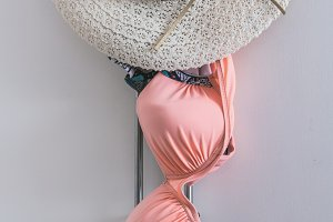 Women's swimsuit with straw hat hang
