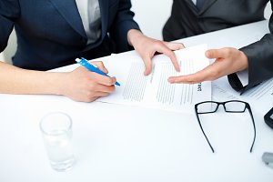 businessman's hands signing