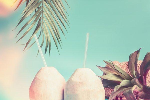 Beach coconut cocktails on blue