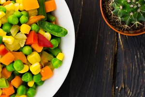 Salad of colorful vegetables is close.