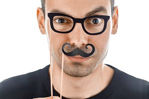 man with paper moustaches