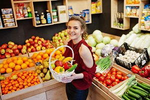 Girl in fruits store