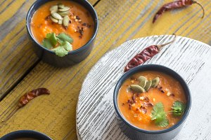 Bowls of pumpkin cream soup