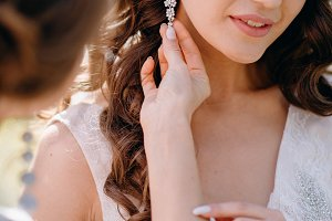 Girlfriend dresses bride's earrings