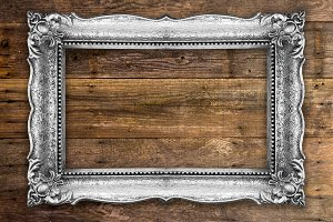 Old Picture Frame on wooden backgrou