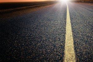Road heading the sun