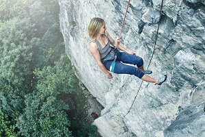 woman rock climber climbed on the cliff