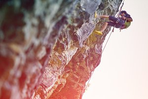 male rock climber on the cliff