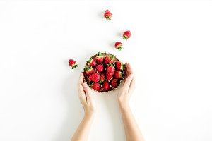 Strawberry in female hands