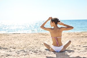 beautiful sexual woman in bikini against the sea and sky