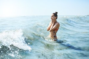 happy smiling woman is swimming in the sea