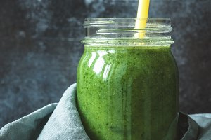 Detox green smoothie in glass bottle