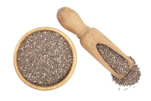 Chia seeds in wooden bowl and scoop isolated on white background. Top view