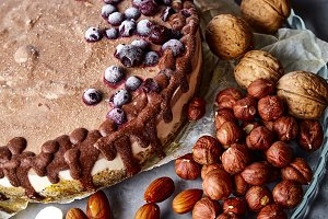 Chocolate vegan cake with different nuts, dates and carob
